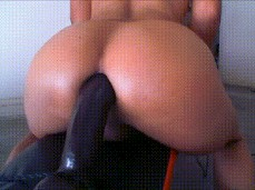 riding a big black dildo with perfect ass