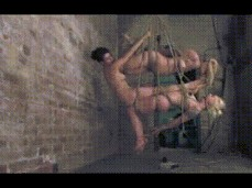 Three slaves suspended by rope